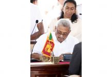 Sri Lanka's new President Gotabaya Rajapaksa signs documents during his swearing-in ceremony at the Ruwanwelisaya temple in Anuradhapura.