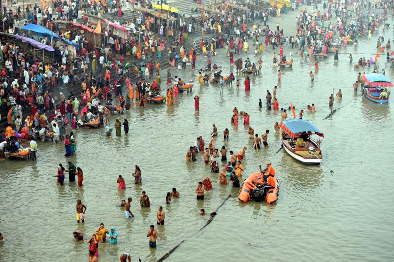 Devotees taking Holy dip in Saryu river on occasion of Kartik Purnima in Ayodhya on Tuesday. (UNI)
