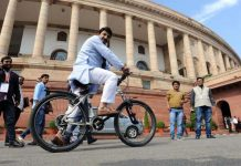 Bharatiya Janata party leader Manoj Tiwari arrives on a bicycles to highlight alarming levels of pollution in the city on the opening day of the winter session of the Parliament in New Delhi on Monday.