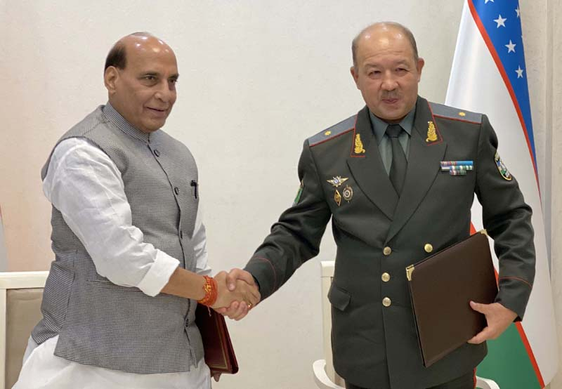 Defence Minister Rajnath Singh and Uzbekistan Defence Minister Maj Gen Bakhodir Nizamovich Kurbanov after signing an MoU, in Tashkent on Saturday. (UNI)