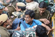 Police stop Jawaharlal Nehru University (JNU) students who were staging a protest over the hostel-fee hike and the administration's alleged 'anti-students' policy, in New Delhi on Monday.