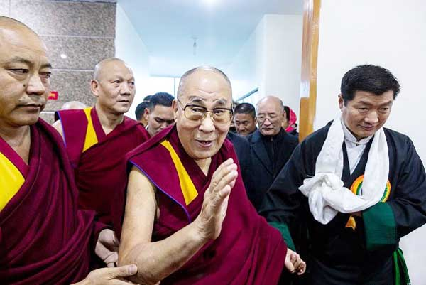 Tibetan spiritual leader the Dalai Lama arrives to attend the last day of a three-day religious conference in Dharamsala. Representatives of Tibetan Buddhist schools and the ancient Bon religion attended the conference.