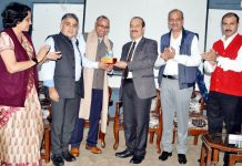 JU VC presenting a memento to Prof Ramesh C Gaur who delivered a lecture at HRDC on Wednesday.