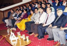 JU Vice - Chancellor and others witnessing screening of a documentary of Wednesday.