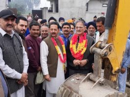 Former Deputy CM, Kavinder Gupta kick starting drainage work at Gangyal on Thursday.