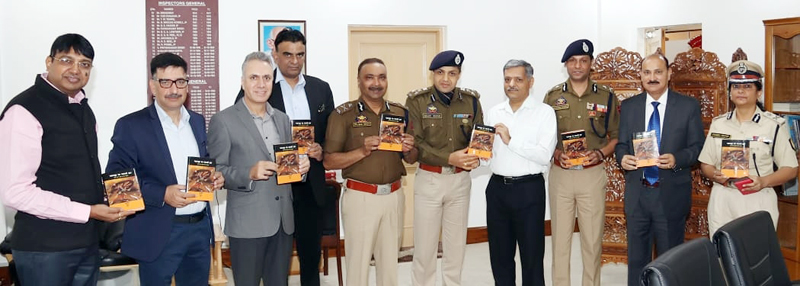 DGP and other officers launching DIG Sujit Kumar's book titled 'Chakarvyuh Ka Saatwaan Dwar' at Jammu on Friday.