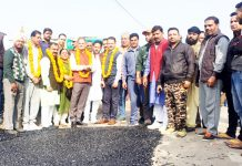 Former Deputy CM Kavinder Gupta kickstarting blacktopping work at Qasim Nagar, Jammu on Wednesday.