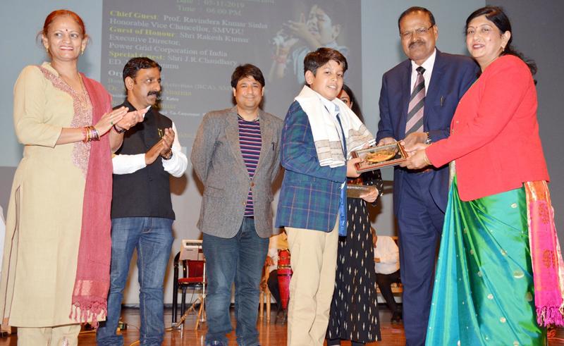 Child artist Kaustabh M Kunj being honoured by V C SMVDU on Friday.