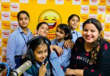 Children posing with RJ of 98.3 Mirchi at Mirchi studio in Jammu.