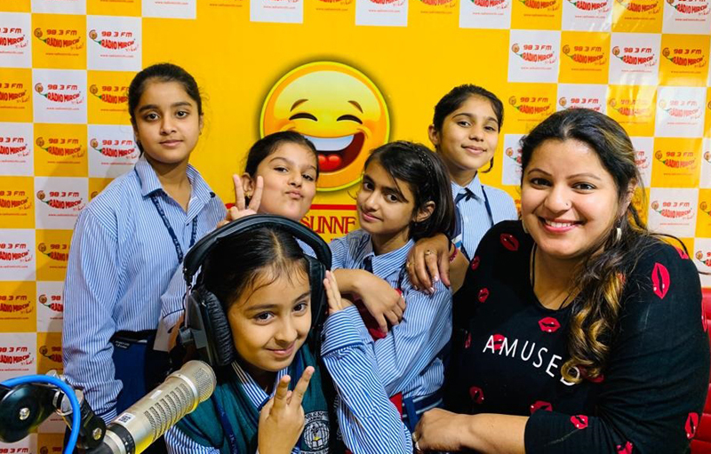 Children posing with RJ of 98.3 Mirchi at Mirchi studio in Jammu.