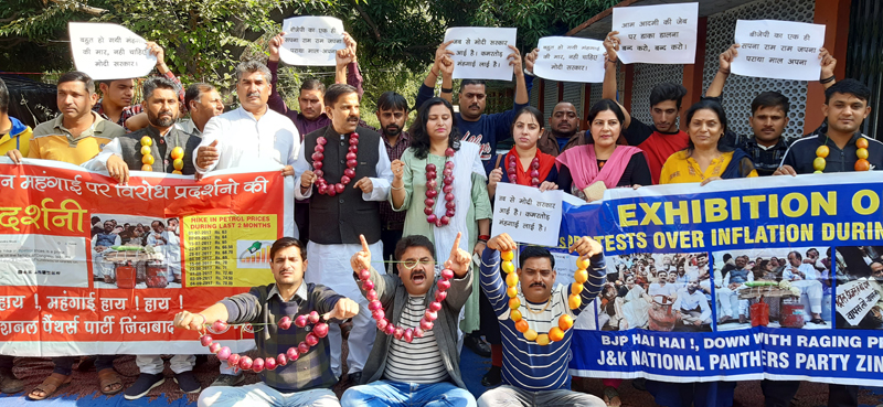 NPP activists with onion garlands staging protest in Jammu on Friday.