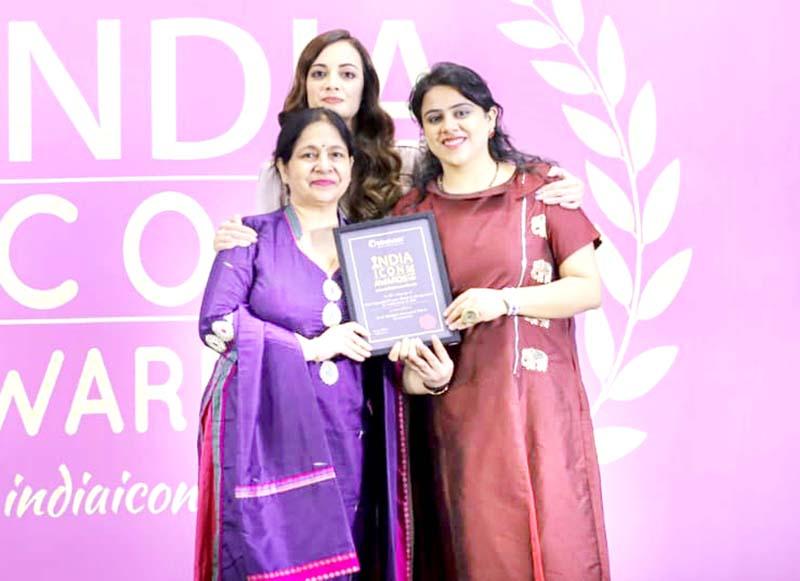 Chairperson, Knowracle Group, Ved Mahajan and Director Swati Mahajan posing with UN Goodwill Ambassador and actress Dia Mirza after receiving the award.