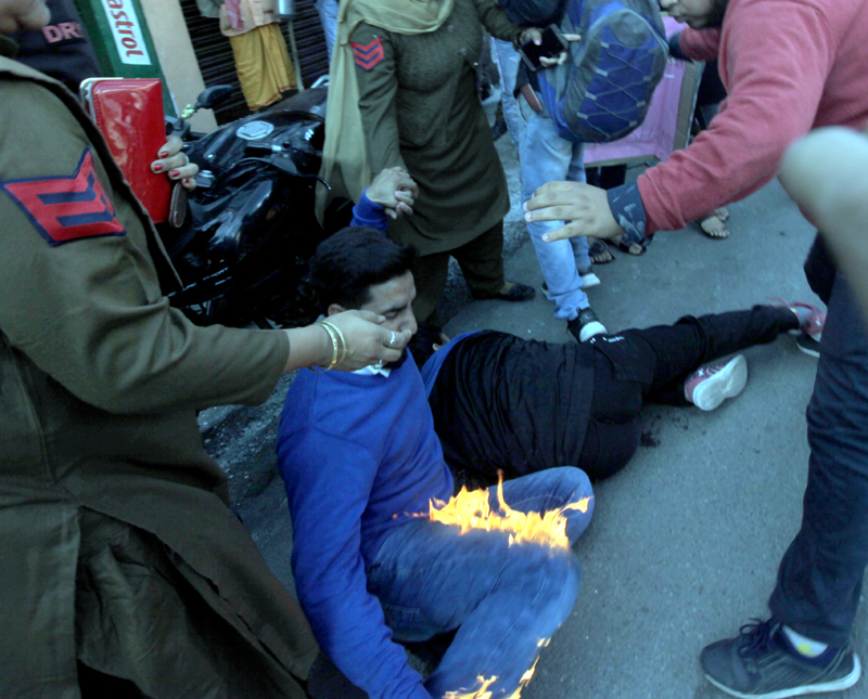 A protester accidentally catches fire while torching effigy during ABVP demonstration on Sunday.