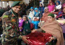 Major General, Ravi Murugan, GOC Delta Force presenting gift to a war widow during ex-servicemen rally in Doda.