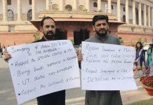 PDP Rajya Sabha members Mir Fayaz and Nazir Ahmed Laway protesting inside the Parliament House premises on Monday. (UNI)