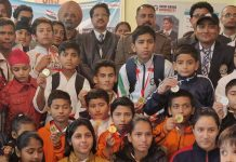 Medal winners of Inter-School and Senior Karate championship posing with chief guest, Chief Engineer (Retd), K K Gupta at Jammu on Friday.