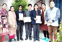 Bhavya and Shivangi posing along with SOS School Management in Jammu.