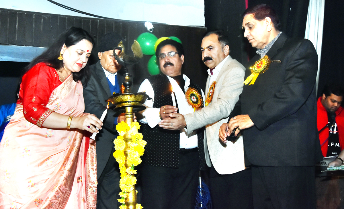Chief guest and other dignitaries lighting ceremonial lamp during Annual Day celebration at Scientia International School.