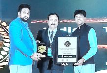 Principal Model Academy, Pramod Kumar Srivastava receiving prestigious award in Bengaluru.