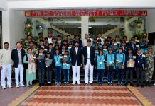 Children posing for group photograph with BSF officers before leaving for 'Bharat Darshan' tour.