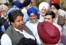 Farmers interacting with Cong leader Raman Bhalla in Jammu on Saturday.