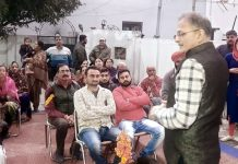 Kavinder Gupta addressing BJP workers & his supporters at Gangyal on Saturday.