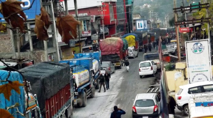 Large number of vehicles stranded at Chanderkote near Ramban due to closure of National Highway on Saturday. -Excelsior/Parvaiz Mir