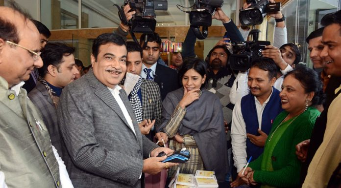 Union Minister for Road Transport & Highways and Micro, Small & Medium Enterprises, Nitin Gadkari launching sale of Khadi Rumal, stitched by the women of militancy affected families of J&K, in New Delhi on Tuesday.