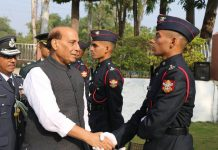 Defence Minister Rajnath Singh shakes hands with a cadet at NDA Pune on Saturday.