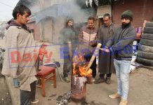 People warm themselves on a cold day in Srinagar. - Excelsior/Shakeel