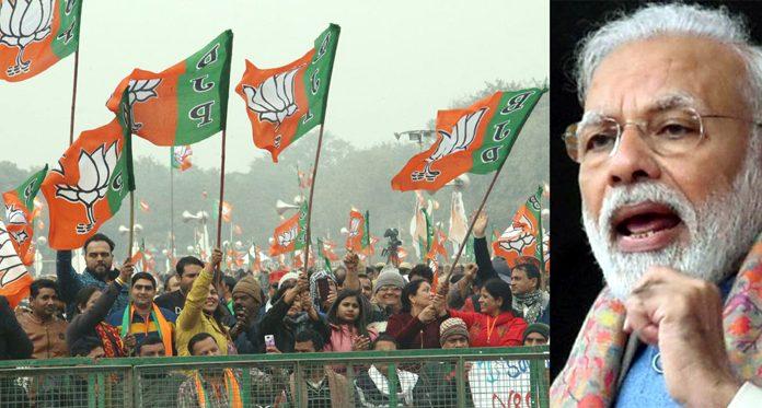 Prime Minister Narendra Modi addressing a rally at Ram Leela Maidan in New Delhi on Sunday. (UNI)