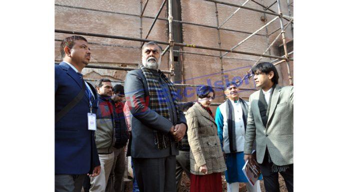 Union MoS Tourism Prahlad Singh Patel inspecting conservation work at Mubarak Mandi Complex in Jammu on Tuesday. -Excelsior/Rakesh