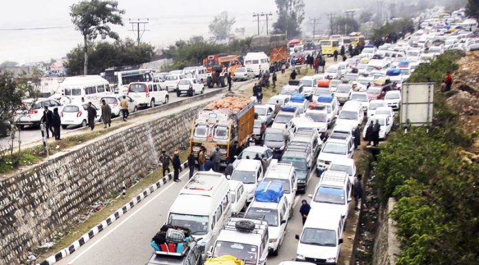 Massive traffic mess created at Nagrota Bypass near Jammu on Friday morning. -Excelsior/Rakesh