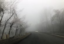 Fog engulfs Baramulla-Kupwara highway on Monday. — Excelsior/Aabid Nabi