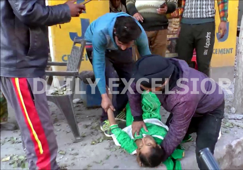 People shift a shelling victim to hospital in Poonch on Tuesday. -Excelsior/Gurjitbhajan