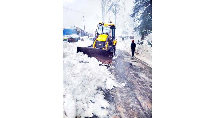 Snow clearance work in progress at Patnitop. -Excelsior/Parvez Mir