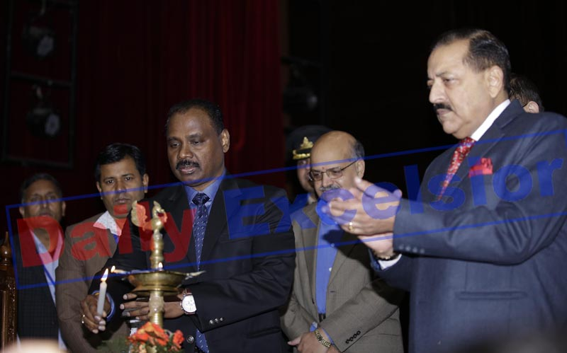 Union Minister Dr Jitendra Singh, Lt Governor Girish Chandra Murmu and Chief Secretary B V R Subrahmanyam lighting the lamp at a conference on 'Jal Shakti and Disaster Management' at Jammu on Saturday. -Excelsior/Rakesh