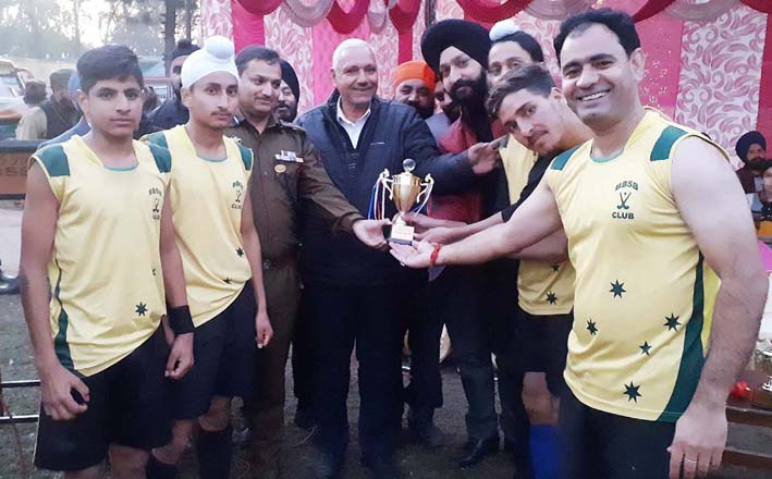 Players of BSB Hockey Club after winning Waryam Memorial Hockey match in Poonch on Monday.