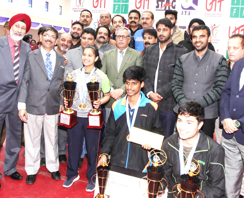 Table Tennis Champs posing along with Advisor Farooq Khan and other dignitaries during concluding ceremony of 81st UTT Junior and Youth Nationals in Jammu on Sunday. -Excelsior/Rakesh