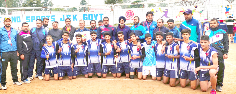 J&K U-17 Volleyball team posing along with support staff and officials after scripting win against Telangana at Khel Gaon Nagrota on Thursday.