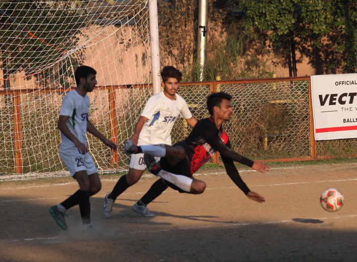 Goalkeeper making a valiant effort to get hold of the ball during a match of 13th Christmas Gold Cup Football Tournament in Jammu. —Excelsior/Rakesh