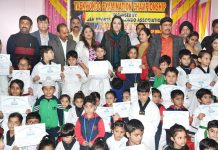 Winners of Taekwondo Examination Championship posing along with Dr Sehrish Asgar in Jammu on Sunday.