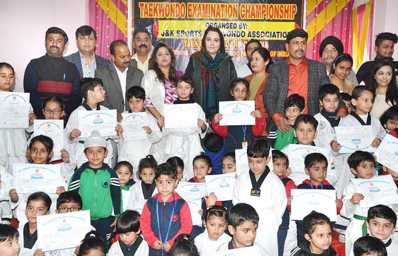 Winners of Taekwondo Examination Championship posing along with Dr Sehrish Asgar in Jammu on Sunday.