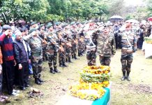 Army jawan being paid floral tributes at Vijaypur on Friday. -Excelsior/ Badyal