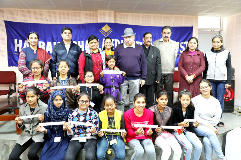 Students posing for a group photograph during scholarship carnival by HBET in Jammu.