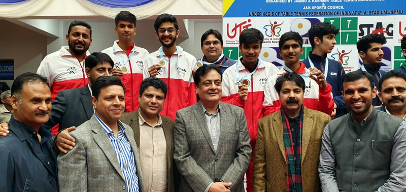 Delhi team posing along with Vipul Mittra, Additional Chief Secretary, Labour and Employment Deptt Govt of Gujarat and other dignitaries after clinching Youth Boys title on Thursday.