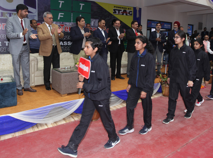 Advisor Farooq Khan along with other dignitaries inspecting March Past during opening ceremony of 81st UTT Junior and Youth Nationals in Jammu on Monday. —Excelsior/Rakesh