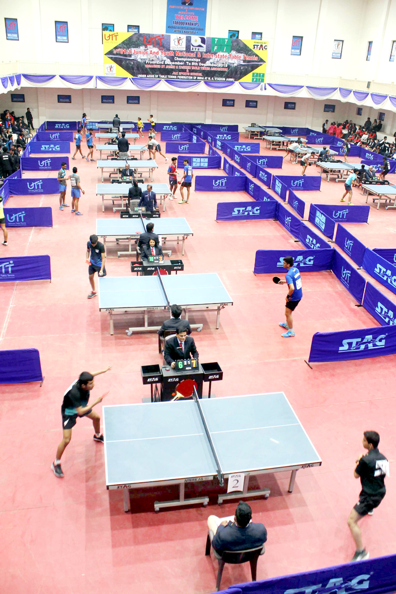 Paddlers in action on the second day of the 81st Junior and Youth Nationals Table Tennis Championship at Indoor Hall, Maulana Azad Stadium in Jammu on Tuesday. (UNI)