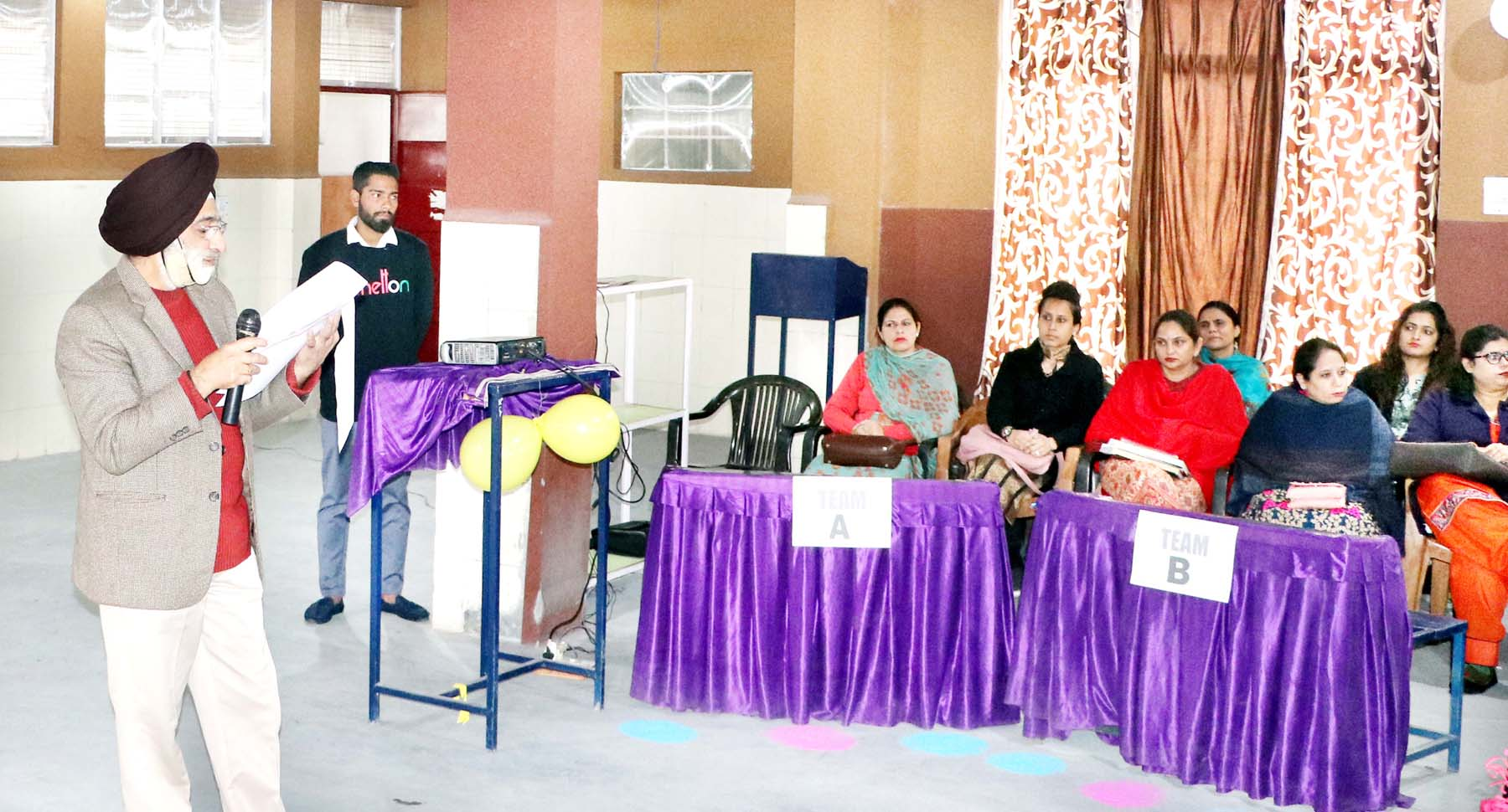 Quiz Master being listened carefully by the students at Shiksha Niketan School in Jammu.