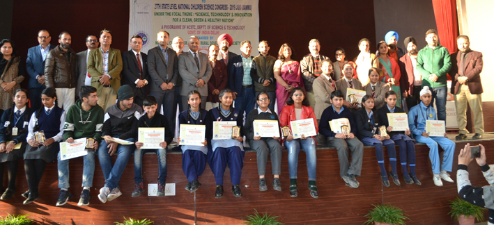 Participants displaying certificates while posing for a gropup photograph during concluding ceremony of 27th National Children Science Congress 2019 at Jodhamal School in Jammu.